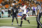 FILE - In this Nov. 23, 2019, file photo, San Diego State quarterback Ryan Agnew (9) scores a touchdown against Hawaii during the second half of an NCAA college football game in Honolulu. San Diego State and Central Michigan meet Saturday, Dec. 21, 2019, in the New Mexico Bowl in Albuquerque, N.M. in a game expected to be a defensive battle. (AP Photo/Marco Garcia,File)