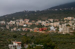 Smoke has cleared in the Ain Qana village where an explosion rocked a Hezbollah stronghold, in southern Lebanon, Tuesday, Sept. 22, 2020. The powerful explosion sent thick grey smoke billowing over the village, but the cause was not clear. (AP Photo/Mohammed Zaatari)