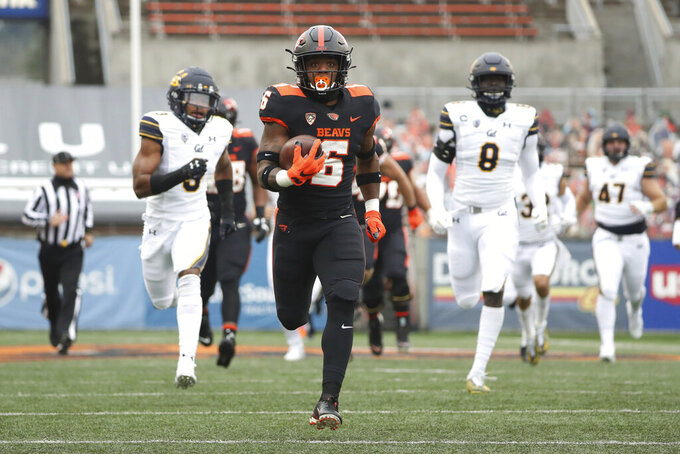 FILE - In this Nov. 21, 2020, file photo, Oregon State running back Jermar Jefferson (6) runs 75-yards to score a touchdown on the first play of an NCAA college football game against California in Corvallis, Ore. Jefferson was selected as the PAC-12 offensive player of the year along with Colorado running back Jarek Broussard.  (AP Photo/Amanda Loman, File)