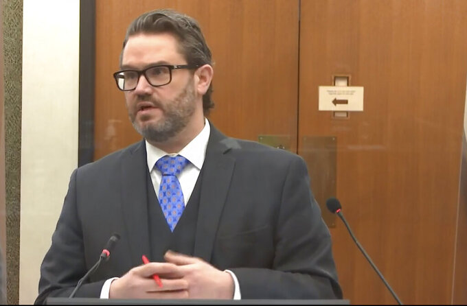 In this image from video, defense attorney Eric Nelson questions Dr. David Fowler as Hennepin County Judge PeterCahill presides, Wednesday, April 14, 2021, in the trial of former Minneapolis police Officer Derek Chauvin at the Hennepin County Courthouse in Minneapolis, Minn.  Chauvin is charged in the May 25, 2020 death of George Floyd.  (Court TV via AP, Pool)