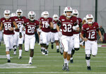 FILE - In this Oct. 26, 2019, file photo Massachusetts players enter the field for an NCAA college football game against Connecticut, in Amherst, Mass. Massachusetts is the latest school from the Football Bowl Subdivision, college football's highest level, to cancel its fall season.  (AP Photo/Jessica Hill, File)