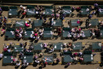 Fans wait for a race while social distancing before 147th running of the Kentucky Oaks at Churchill Downs, Friday, April 30, 2021, in Louisville, Ky. (AP Photo/Charlie Riedel)