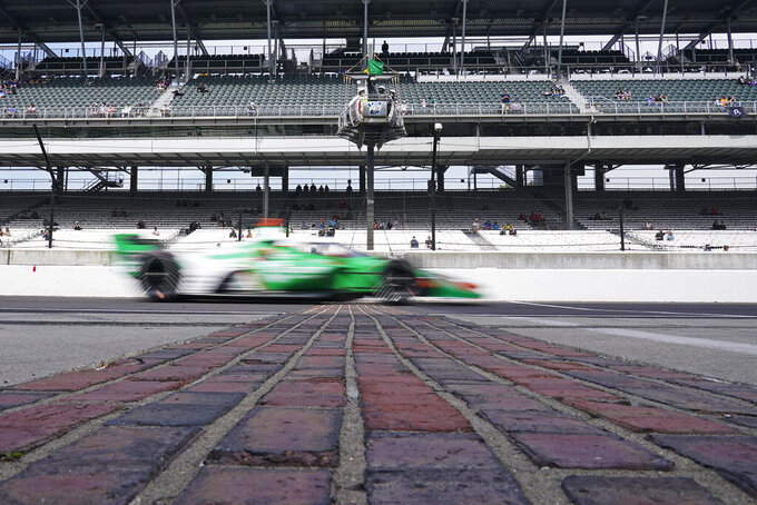 James Hinchcliffe, of Canada, drives down pit lane during a warm-up session for the IndyCar auto race at Indianapolis Motor Speedway, Saturday, May 15, 2021, in Indianapolis. (AP Photo/Darron Cummings)