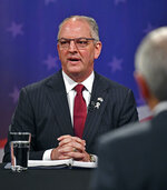 Democratic Louisiana Gov. John Bel Edwards speaks on set before the start of the Louisiana Governor's runoff debate, Wednesday, Oct. 30, 2019, at Louisiana Public Broadcasting in Baton Rouge, La. (Hilary Scheinuk/The Advocate via AP)