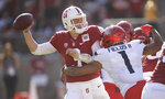 Stanford quarterback K.J. Costello, left, is pressured by Arizona's Tony Fields II (1) during the second half of an NCAA college football game Saturday, Oct. 26, 2019, in Stanford, Calif. (AP Photo/Ben Margot)