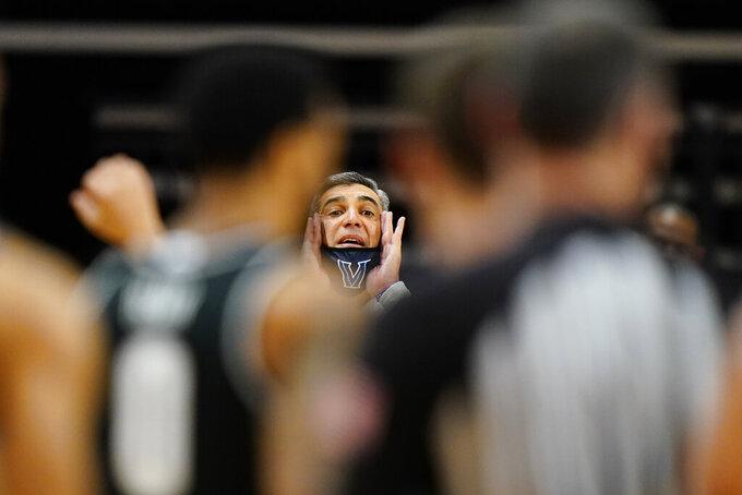 Villanova head coach Jay Wright yells to his team during the first half of an NCAA college basketball game against Georgetown, Sunday, Feb. 7, 2021, in Villanova, Pa. (AP Photo/Matt Slocum)