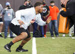 FILE - In this March 26, 2021, file photo, Christian Darrisaw runs a drill Virginia Tech pro day, attended by NFL football scouts, in Blacksburg, Va. If Washington stands pat at quarterback, it could fill a major need at left tackle or linebacker. Offensive tackle Darrisaw or Notre Dame linebacker Jeremiah Owusu-Koramoah would fit that bill. (AP Photo/Matt Gentry, File)