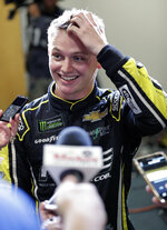 Justin Haley talks with reporters just before he was declared the winner of the NASCAR Cup Series auto race at Daytona International Speedway, Sunday, July 7, 2019, in Daytona Beach, Fla. (AP Photo/John Raoux)