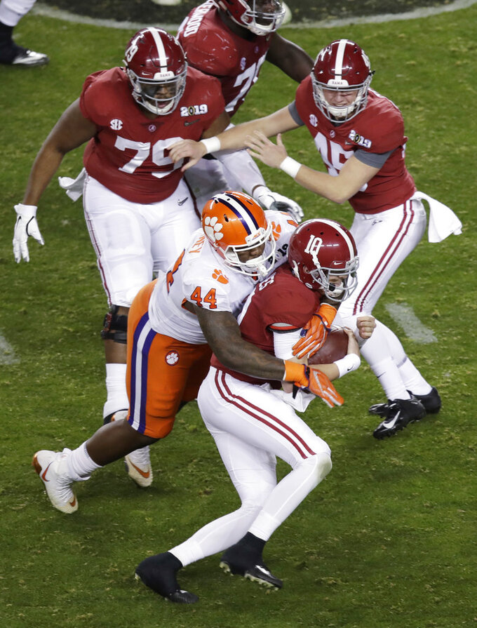 Clemson's Nyles Pinckney stops Alabama's Mac Jones on a fake field goal attempt during the second half of the NCAA college football playoff championship game, Monday, Jan. 7, 2019, in Santa Clara, Calif. (AP Photo/Jeff Chiu)