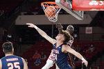 Oklahoma forward Kur Kuath, rear, dunks over UTSA center Jacob Germany (24) during the second half of an NCAA college basketball game Thursday, Dec. 3, 2020, in Norman, Okla. (AP Photo/Sue Ogrocki)