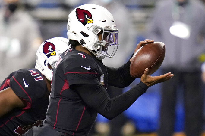 Arizona Cardinals quarterback Kyler Murray takes a snap against the Seattle Seahawks during the first half of an NFL football game, Thursday, Nov. 19, 2020, in Seattle. (AP Photo/Elaine Thompson)