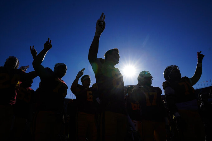 Southern California players sing the school song after a 30-7 win over San Jose State in an NCAA college football game Saturday, Sept. 4, 2021, in Los Angeles. (AP Photo/Ashley Landis)