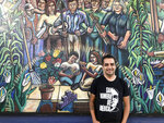 In this Religion News Service photo, Fernando Romero Orozco stands outside the Pomona Economic Opportunity Center, where he is the executive director, Thursday, Nov. 7, 2019, in Pomona, Calif. Wearing a shirt emblazoned with the image of St. Oscar Romero, he says his Mexican identity is deeply linked to the Catholic faith. (Alejandra Molina/RNS via AP)