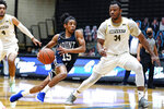 Mount St. Mary's guard Damian Chong Qui (15) drives to the basket against Bryant forward Hall Elisias (34) during the first half of an NCAA college basketball game for the Northeast Conference men's tournament championship Tuesday, March 9, 2021, in Smithfield, R.I. (AP Photo/Charles Krupa)