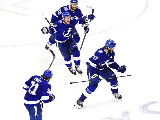 Tampa Bay Lightning defenseman Victor Hedman (77) celebrates his winning goal against the Boston Bruins during the second overtime period of NHL Stanley Cup Eastern Conference playoff hockey game action in Toronto, Monday, Aug. 31, 2020. (Frank Gunn/The Canadian Press via AP)