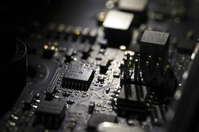 FILE - This Feb 23, 2019, file photo shows the inside of a computer in Jersey City, N.J. Facebook unveiled a broad plan Tuesday, June 18, to create a new digital currency. (AP Photo/Jenny Kane, File)