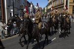Members of the armed forces ride horses along the streets of Windsor, England during a rehearsal for the procession of the upcoming wedding of Britain's Prince Harry and Meghan Markle, England, Thursday, May 17, 2018. Preparations continue in Windsor ahead of the royal wedding of Britain's Prince Harry and Meghan Markle Saturday May 19. (AP Photo/Emilio Morenatti)