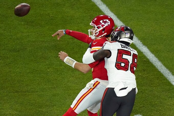Kansas City Chiefs quarterback Patrick Mahomes (15) throws while being pressured by Tampa Bay Buccaneers' Shaquil Barrett (58) during the first half of the NFL Super Bowl 55 football game Sunday, Feb. 7, 2021, in Tampa, Fla. (AP Photo/Charlie Riedel)
