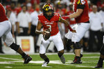 Maryland quarterback Taulia Tagovailoa (3) scrambles with the ball during the first half of an NCAA college football game against Howard, Saturday, Sept. 11, 2021, in College Park, Md. (AP Photo/Nick Wass)