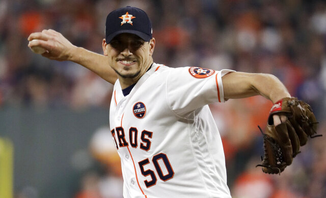 FILE - In this Oct. 28, 2017, file photo, Houston Astros starting pitcher Charlie Morton throws against the Los Angeles Dodgers during the second inning of Game 4 of baseball's World Series in Houston. Two-time All-Star pitcher Morton says he regrets not doing anything to try to stop the Astros from illegally stealing signs and relaying information to their hitters during the team's 2017 World Series championship season. Morton currently is the ace of the Tampa Bay Rays. (AP Photo/Matt Slocum, File)
