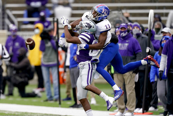 Kansas State defensive back Cameron Key (27) breaks up a pass intended for Kansas wide receiver Ezra Naylor II (11) during the second half of an NCAA college football game Saturday, Oct. 24, 2020, in Manhattan, Kan. (AP Photo/Charlie Riedel)