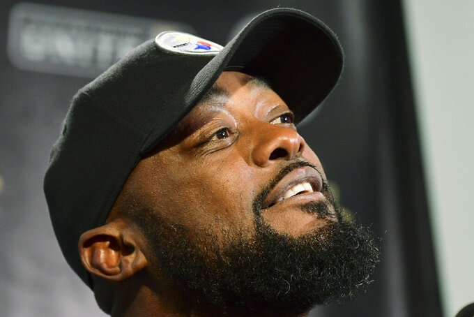 Pittsburgh Steelers head coach Mike Tomlin takes questions at the news conference after an NFL football game against the Seattle Seahawks, Monday, Oct. 18, 2021, in Pittsburgh. The Steelers won 23-20 in overtime. (AP Photo/Fred Vuich)