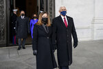 Former Vice President Mike Pence and his wife, Karen Pence, followed by Vice President Kamala Harris and her husband Doug Emhoff, walk out of the Capitol after the inauguration of President Joe Biden Wednesday, Jan. 20, 2021, at the U.S. Capitol in Washington.  (Melina Mara/The Washington Post via AP, Pool)