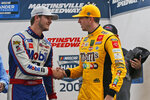 Kyle Busch, right, shakes the hand of Todd Gilliland as he celebrates winning the NASCAR Truck Series race at Martinsville Speedway in Martinsville, Va., Saturday, Oct. 26, 2019, (AP Photo/Steve Helber)