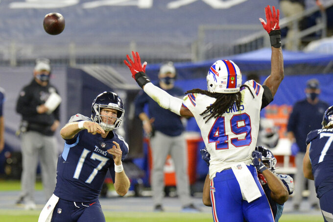 Tennessee Titans quarterback Ryan Tannehill (17) passes as he is pressured by Buffalo Bills middle linebacker Tremaine Edmunds (49) in the first half of an NFL football game Tuesday, Oct. 13, 2020, in Nashville, Tenn. (AP Photo/Mark Zaleski)