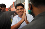 Sri Lanka's main opposition candidate Sajith Premadasa greets his supporters as he leaves after a meeting in Colombo, Sri Lanka,  July 31, 2020. The UNP, the largest political party in the country, is divided and a breakaway party led by Sajith Premadasa is likely to return the second highest number of lawmakers in the 225-member Parliament. (AP Photo/Eranga Jayawardena)