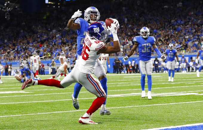 New York Giants wide receiver Darius Slayton (86), defended by Detroit Lions cornerback Rashaan Melvin (29), catches a 28-yard pass for a touchdown during the first half of an NFL football game, Sunday, Oct. 27, 2019, in Detroit. (AP Photo/Paul Sancya)