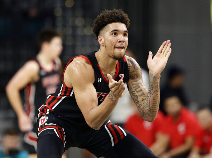 Utah forward Timmy Allen reacts following a basket against Coastal Carolina during the first half of an NCAA college basketball game at the Myrtle Beach Invitational in Conway, S.C., Thursday, Nov. 21, 2019. (AP Photo/Gerry Broome)
