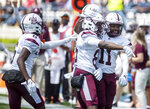 Alabama A&M players celebrates a touchdown against Jackson State during an NCAA college football game, Saturday, April 10, 2021, at Veterans Memorial Stadium in Jackson, Miss. (Eric Shelton/The Clarion-Ledger via AP)