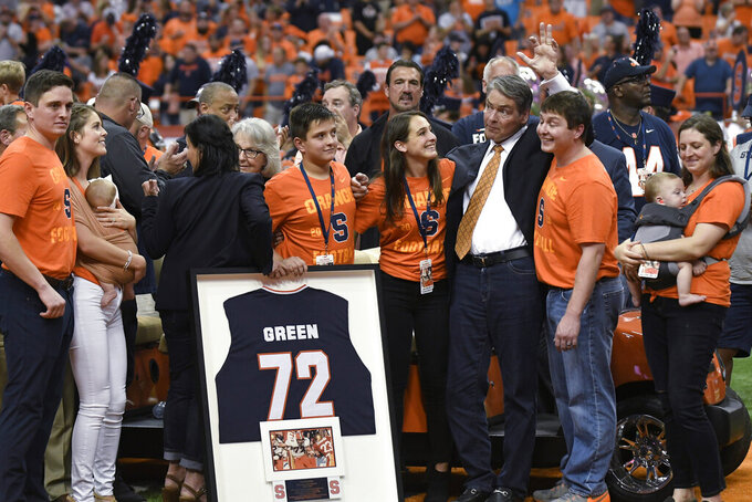 Former Syracuse and NFL football player Tim Green waves as his number is retired during the NCAA college football game between Syracuse and Clemson, Saturday, Sept. 14, 2019, in Syracuse, N.Y. (AP Photo/Steve Jacobs)