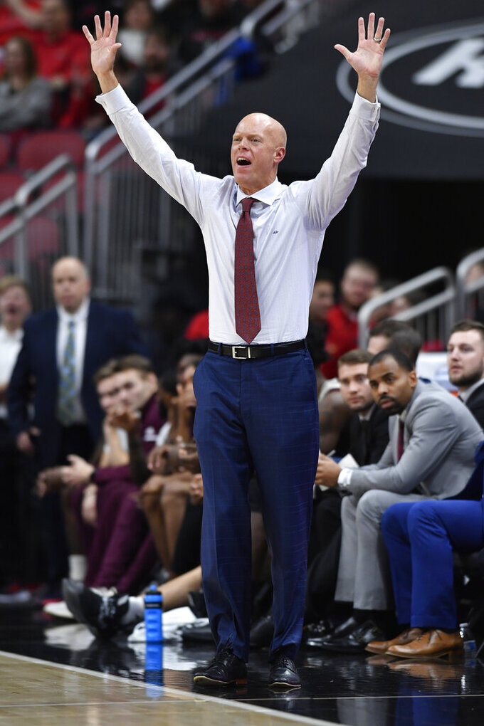 Eastern Kentucky head coach A.W. Hamilton shouts instructions to his team during the second half of an NCAA college basketball game against Louisville in Louisville, Ky., Saturday, Dec. 14, 2019. Louisville won 99-67. (AP Photo/Timothy D. Easley)