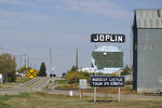A welcome sign for the town of Joplin, Mont., is shown Monday, Sept. 27, 2021. An Amtrak train derailed Saturday near the town, killing three people and injuring others. Federal investigators are seeking the cause of the derailment. (AP Photo/Ted S. Warren)