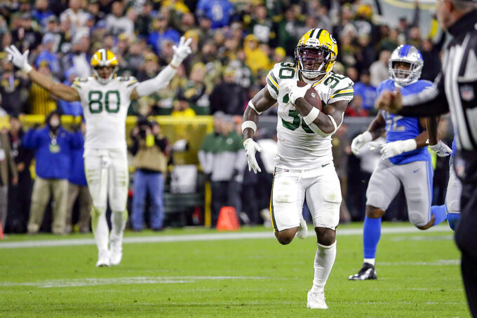 Green Bay Packers running back Jamaal Williams (30) rushes for long yardage during the first half of an NFL football game against the Detroit Lions, Monday, Oct. 14, 2019, in Green Bay, Wis. (AP Photo/Mike Roemer)