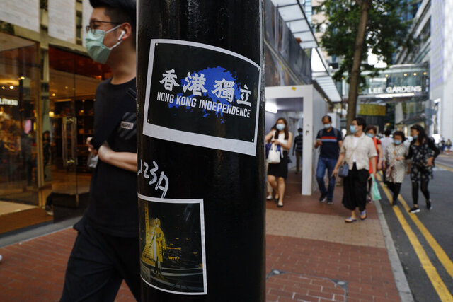Stickers with messages of the pro-democracy movement are left by protesters on a street in Hong Kong, Thursday, July 2, 2020. Hong Kong police have made the first arrests under a new national security law imposed by mainland China, as thousands of people defied tear gas and pepper pellets to protest against it. Police say they arrested 10 people under the law, including at least one who was carrying a Hong Kong independence flag. (AP Photo/Kin Cheung)