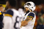 """FILE - In this Saturday, Oct. 13, 2018 file photo, West Virginia quarterback Will Grier watches from the bench during the second half of an NCAA college football game against Iowa State in Ames, Iowa. West Virginia was held to 115 yards of offense against Iowa State, and Grier says """"we have to be able to produce better"""" heading into Thursday night's home game against Baylor. (AP Photo/Charlie Neibergall, File)"""