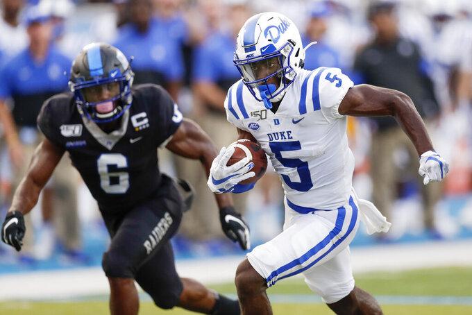 Duke wide receiver Jalon Calhoun (5) gets past Middle Tennessee linebacker Khalil Brooks (6) as Calhoun scores a touchdown in the first half of an NCAA college football game Saturday, Sept. 14, 2019, in Murfreesboro, Tenn. (AP Photo/Mark Humphrey)