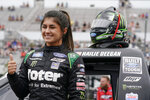 Driver Hailie Deegan poses for a photo before the start of a NASCAR Truck Series auto race at Pocono Raceway, Saturday, June 26, 2021, in Long Pond, Pa. (AP Photo/Matt Slocum)