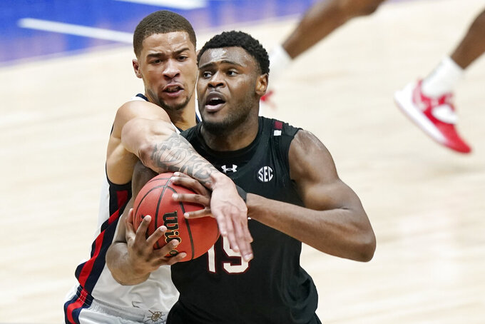 South Carolina's Wildens Leveque (15) battles for a rebound with Mississippi's KJ Buffen, left, in the first half of an NCAA college basketball game in the Southeastern Conference Tournament Thursday, March 11, 2021, in Nashville, Tenn. (AP Photo/Mark Humphrey)