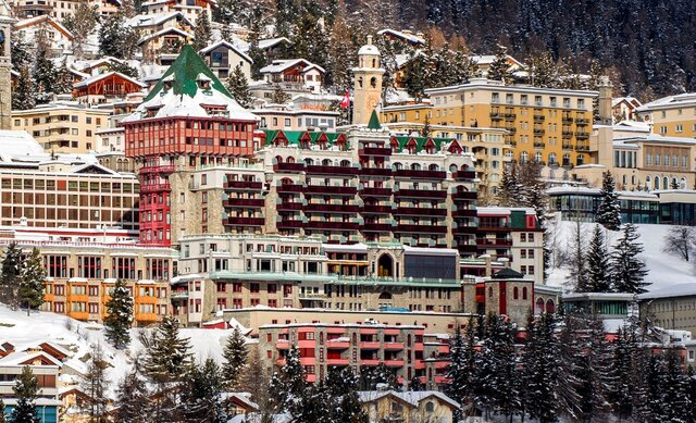 Exterior view of the hotel Badrutt's Palace, center, in St. Moritz, Switzerland, Monday, Jan. 18, 2021. Swiss authorities say they have placed two hotels under quarantine and ordered all guests and employees be tested after a new variant of the coronavirus was detected among them in the upscale skiing resort of St. Moritz. (Giancarlo Cattaneo/Keystone via AP)