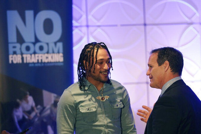 Miami Dolphins wide receiver Albert Wilson, left, speaks with Ray Martinez, executive director of the Miami Super Bowl Host Committee, during a meeting between law enforcement officials and hotel groups to announce a campaign to prevent human trafficking surrounding next month's Super Bowl football game in the Miami area, Thursday, Jan. 9, 2020, in Miami Beach, Fla. (AP Photo/Lynne Sladky)