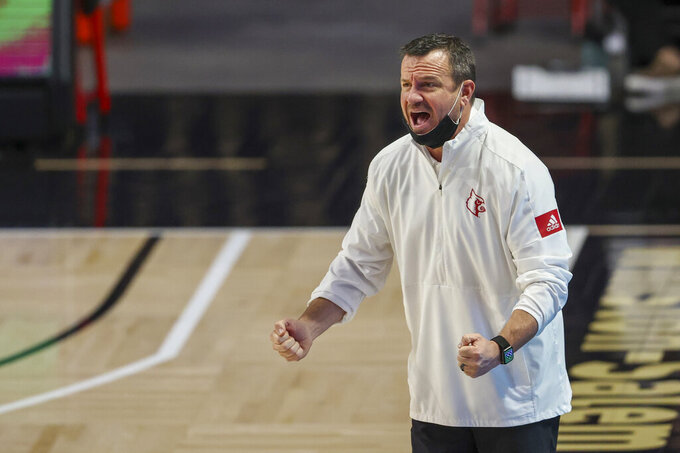 Louisville head coach Jeff Walz directs his team against Wake Forest in the fourth quarter of an NCAA women's college basketball game in Winston-Salem, N.C., Sunday, Jan. 24, 2021. Louisville won 65-63. (AP Photo/Nell Redmond)