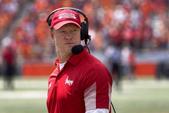 Nebraska head coach Scott Frost looks down the sideline during the first half of an NCAA college football game against the Illinois Saturday, Aug. 28, 2021, in Champaign , Ill. (AP Photo/Charles Rex Arbogast)