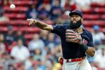 Cleveland Indians' Amed Rosario throws to first base on a groundout by Boston Red Sox's Kevin Plawecki during the sixth inning of a baseball game, Sunday, Sept. 5, 2021, in Boston. (AP Photo/Michael Dwyer)