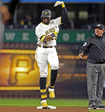 Pittsburgh Pirates' Gregory Polanco (25) gestures to his dugout after doubling off Arizona Diamondbacks starting pitcher Zack Godley as umpire Greg Gibson, right, watches during the fifth inning of a baseball game in Pittsburgh, Monday, April 22, 2019. (AP Photo/Gene J. Puskar)