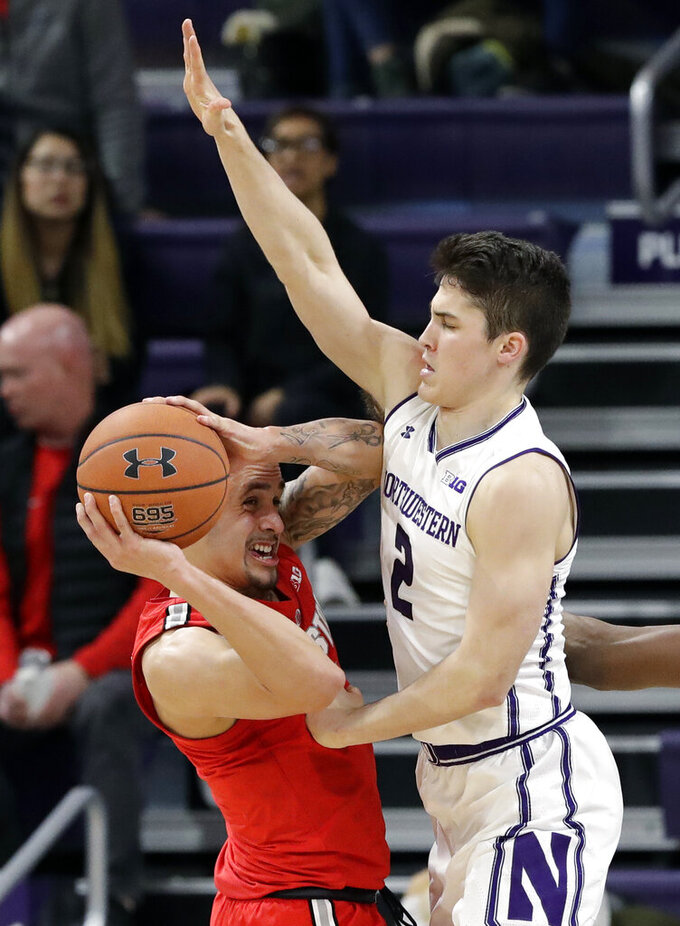 Northwestern guard Ryan Greer, right, guards Ohio State guard Duane Washington Jr. during the second half of an NCAA college basketball game Wednesday, March 6, 2019, in Evanston, Ill. (AP Photo/Nam Y. Huh)