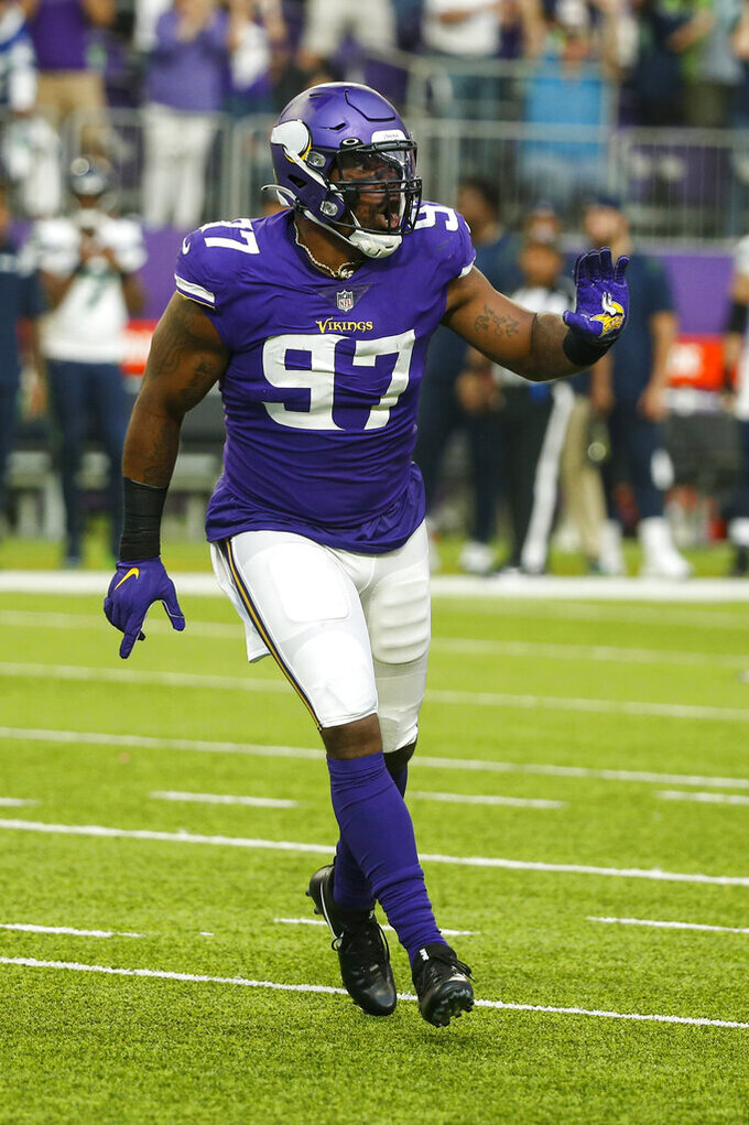 Minnesota Vikings defensive end Everson Griffen (97) celebrates a sack against the Seattle Seahawks in the second half of an NFL football game in Minneapolis, Sunday, Sept. 26, 2021. (AP Photo/Bruce Kluckhohn)